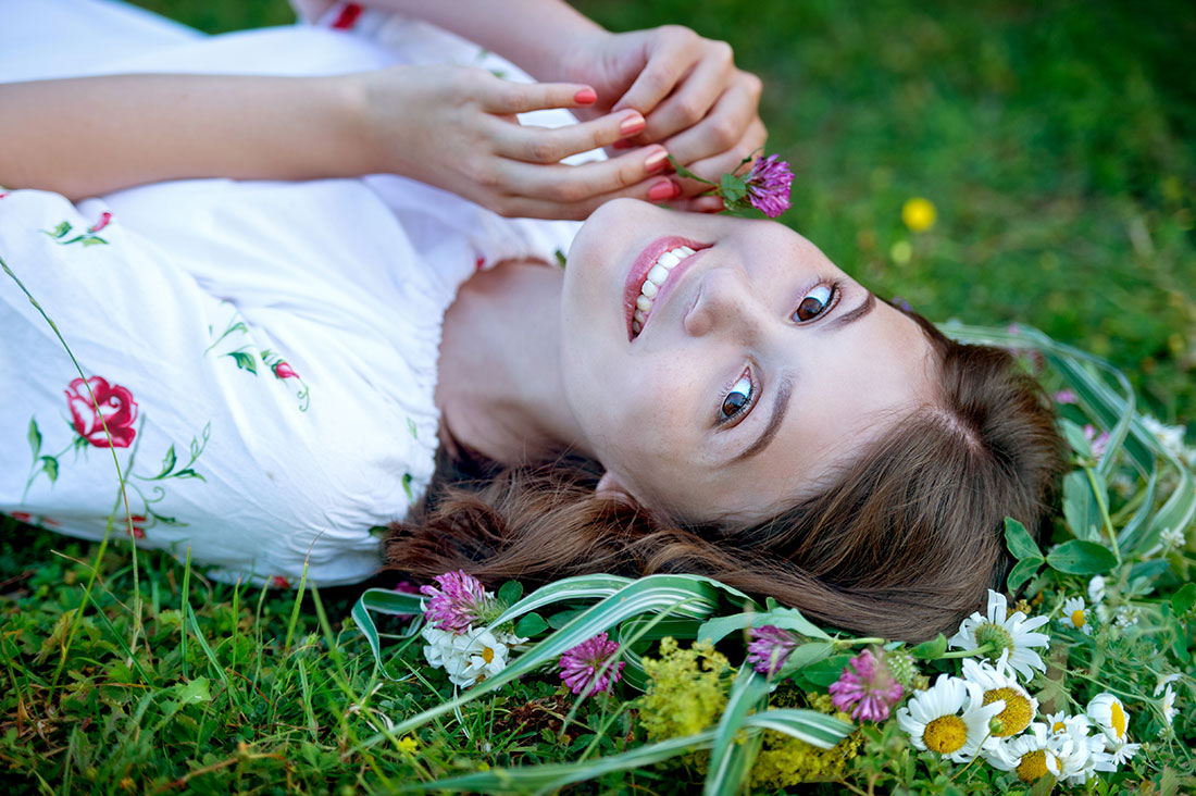 Clear skin girl lying in flowers